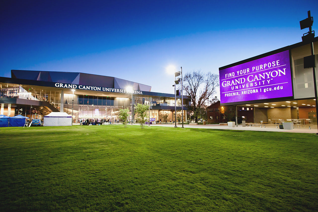 green space with buildings in the background and Grand Canyon University sign